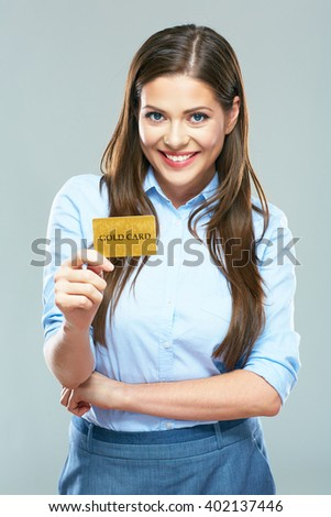Woman Bank employee show credit card. Smiling business woman with long hair studio isolated portrait. - stock photo