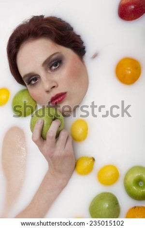 Woman bathing in milk - stock photo