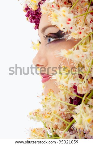 woman beautiful face with chestnut flower frame