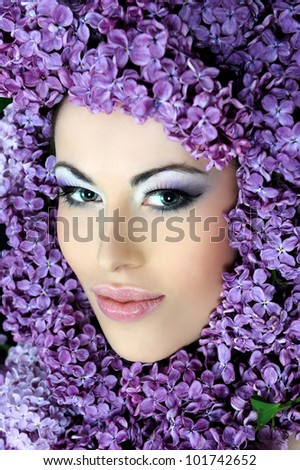 woman beautiful face with flower lilac frame