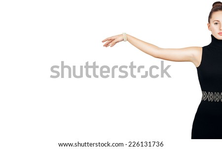 Woman beauty concept. Fashion portrait of young skinny beautiful girl in black dress and perl jewelry. Perfect skin. Half face. Studio shoot.  Copy space. Isolated on white. - stock photo