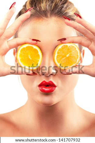 Woman beauty concept with lemon slices over eyes - stock photo