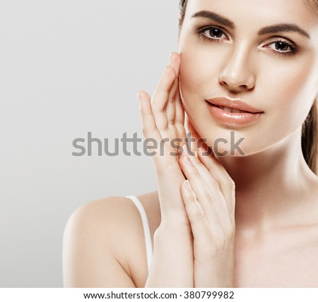 Woman beauty portrait isolated on gray skin care - stock photo
