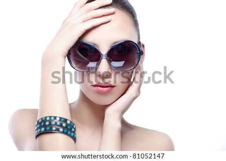 woman beauty sunglasses with hands on the head