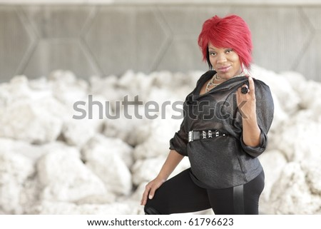 Woman beckoning with her finger - stock photo