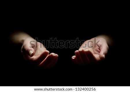 Woman begging with outstretched hands. Hands reaching out. Black and white. - stock photo