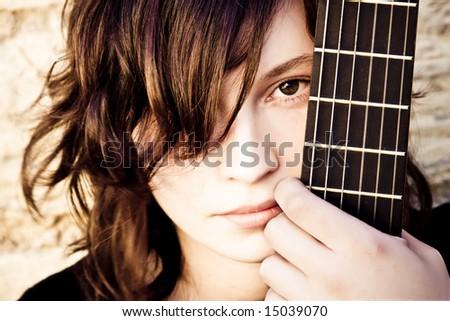 Woman behind fretboard. - stock photo