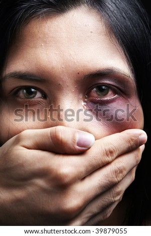 Woman being kidnapped and abused, a concept for domestic violence - stock photo