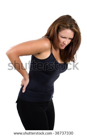 Woman bends over and flinches in pain in her back. - stock photo