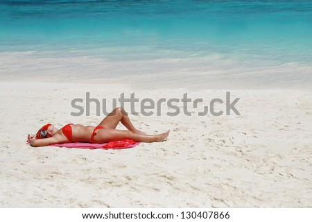 woman bikini sunbathing on beach , beautiful beach surface background ,travel landscape clean white sand beach and blue sea water wave ripple background, beautiful ocean and natural beach island,towel