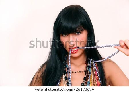 Woman biting lips and teeth in collar - stock photo