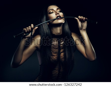 woman biting whip