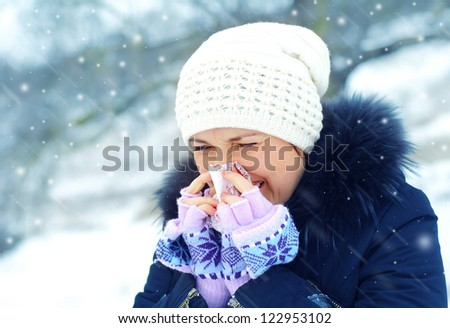 woman blow one's nose - stock photo