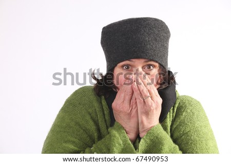Woman blowing hot air in cold hands