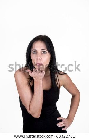 Woman blowing kisses to the camera