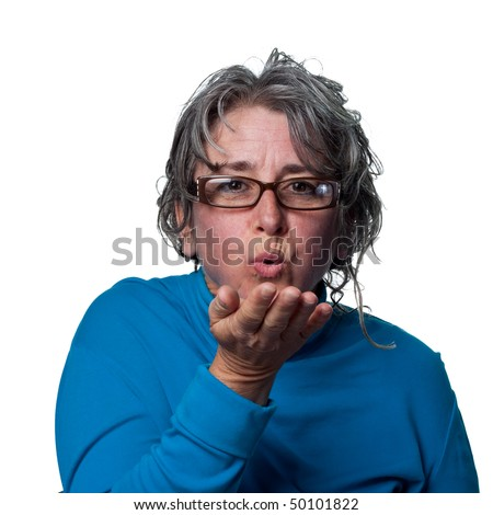Woman blows a kiss and says goodbye - stock photo