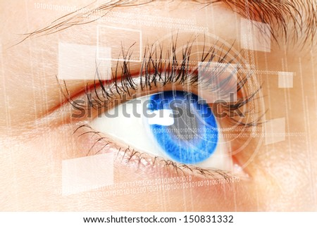 Woman blue eye looking on digital virtual screen close-up  - stock photo