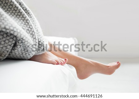 Woman Body Legs Bed Awaking Morning Step Female Foot Sleep Relax Concept - stock photo
