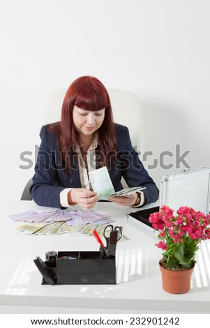 woman boss with a lot of money - stock photo