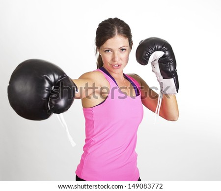 Woman boxing at a gym. Strong, fit woman in action - stock photo
