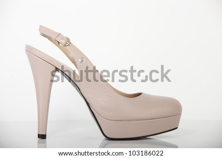 woman brand new shoe on white background