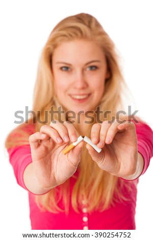 Woman breaking cigarette as a gesture of quitting smoking, breaking unhealthy nicotin adiction.