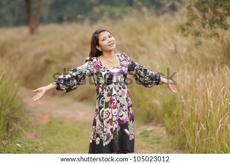 woman breathing in wild nature scenery, thailand - stock photo