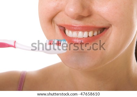 Woman brushing her teeth - stock photo
