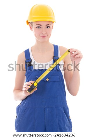 woman builder in blue coveralls holding measure tape isolated on white background - stock photo