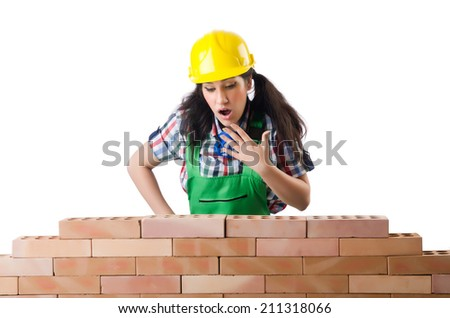 Woman builder isolated on the white - stock photo
