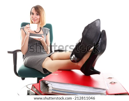 woman businesswoman with plenty of documents, red folders isolated on white, drinking cup of coffee. Young relaxing legs up, work stoppage - stock photo