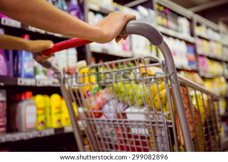 woman buy products with her trolley at supermarket - stock photo