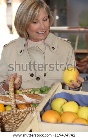 Woman buying fruit - stock photo