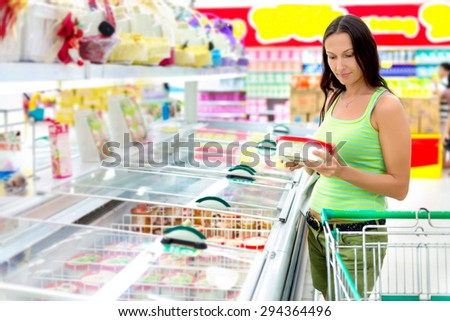 Woman buying ice-cream at the supermarket - stock photo