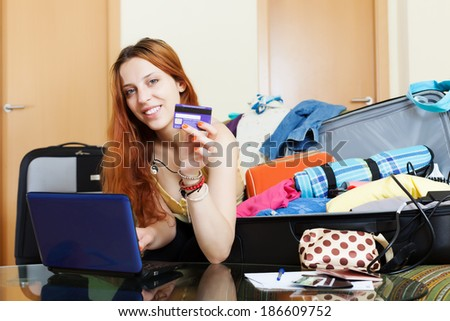 Woman buying tickets  online in  internet - stock photo