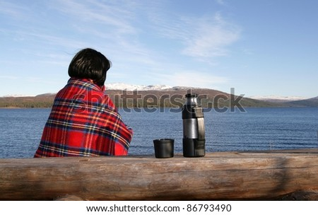 Woman by a lake - stock photo