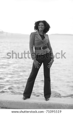 Woman by the bay - stock photo