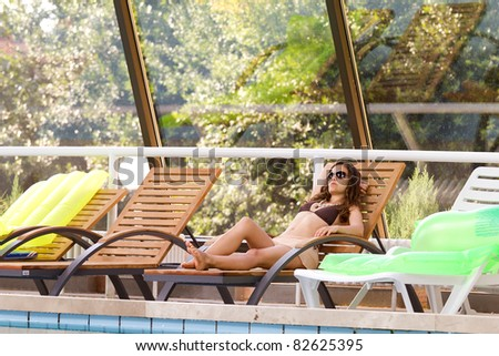 Woman by the swimming pool - stock photo