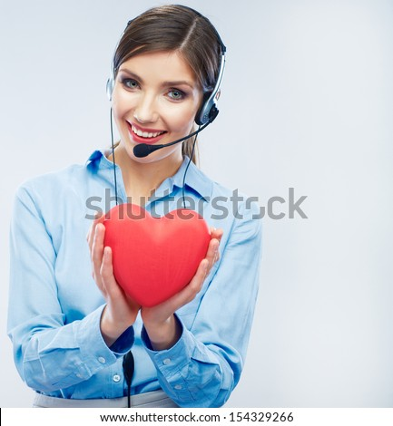 Woman call center operator hold love symbol of Valentine day. Red heart. Close up business woman portrait. - stock photo