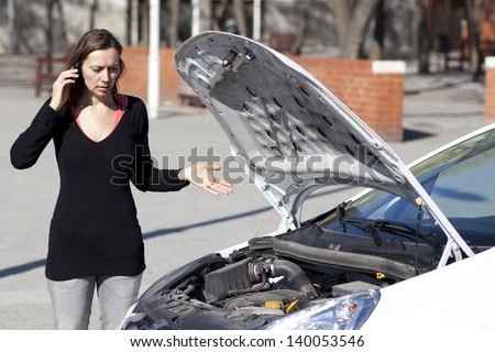 Woman calls roadside assistance - stock photo