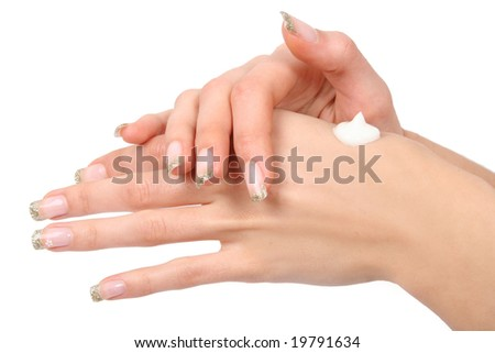 woman caring for her hands - stock photo