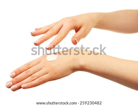 Woman caring hands with cream isolated on white - stock photo