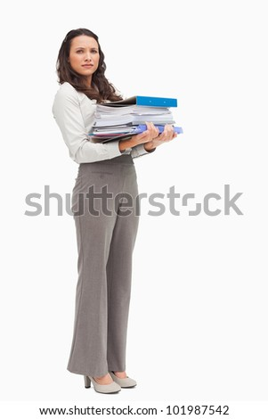 Woman carrying a lot of files against white background
