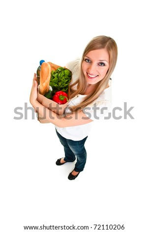 Woman carrying bag of groceries isolated on white - stock photo