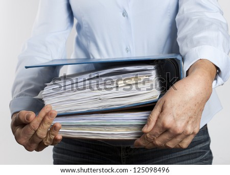 woman carrying binders - stock photo