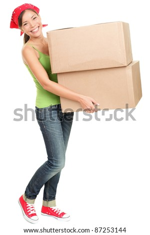 Woman carrying moving boxes. Young woman moving house to new home holding cardboard boxes isolated on white background standing in full length. - stock photo