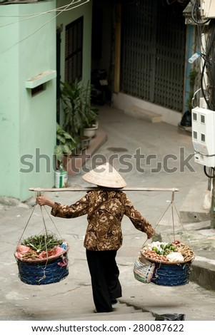 Woman Carrying Produce, in Hanoi, Vietnam - stock photo