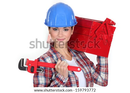 Woman carrying tool box