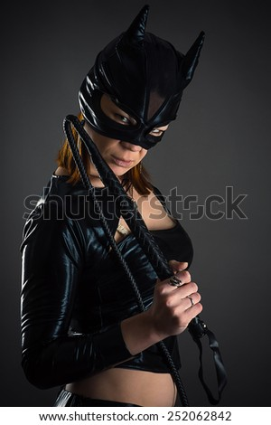 woman cat with whip  - stock photo
