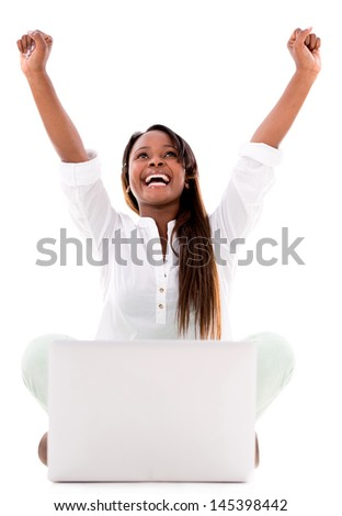 Woman celebrating her online success with a laptop - isolated over white